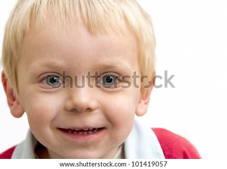 Blond boy smiling for the camera