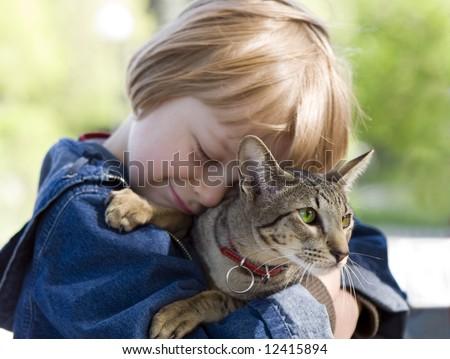 Blond boy with oriental bred cat (series Children, Animals) - stock photo