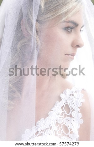 Blond bride with curly locks and beautiful features #57574279