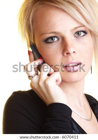 Blond business woman with mobile phone looking into the camera