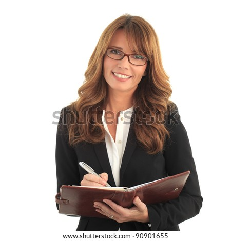 Blond business woman writing in her notebook