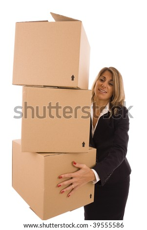 Blond businesswoman carrying three cardboard boxes