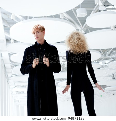 Blond couple classic movie secret agent and sexy girl in black