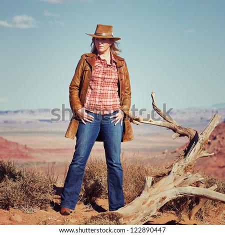 blond cowgirl in the desert, Utah, USA - stock photo