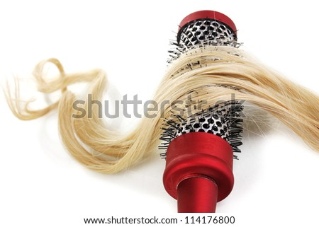 Blond curls brushing comb isolated on white