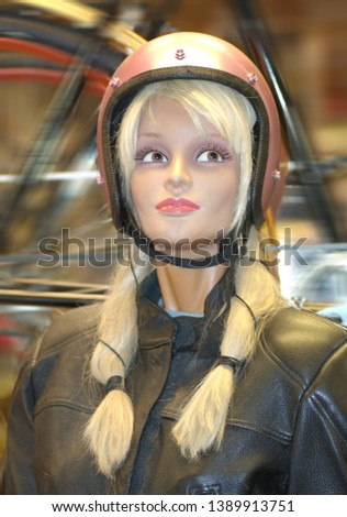 Blond doll with braids and helmet #1389913751