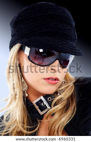 blond fashion woman portrait wearing sunglasses and a black hat