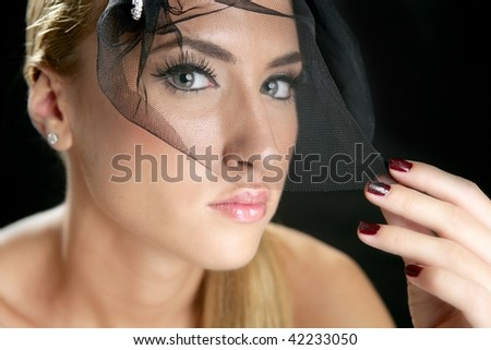 Blond fashion woman portrait with tulle over black
