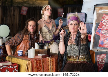 Blond female fortune teller displaying an evil eye in her palm