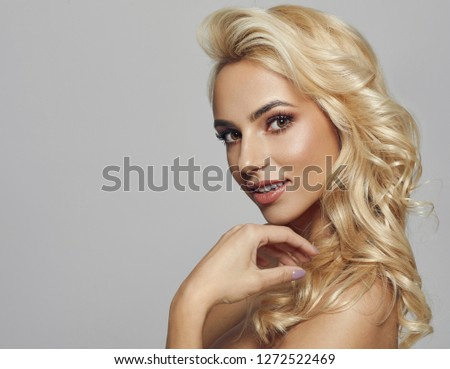 blond female model looking at camera and smiling  #1272522469
