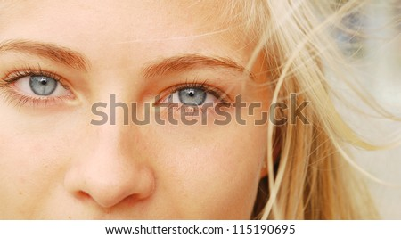 Blond Girl. Blonde Woman with Blue Eyes.