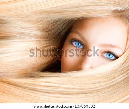Stock Photo Blond Girl. Blonde Woman with Blue Eyes. Healthy Long Blond Hair. Hair Extension