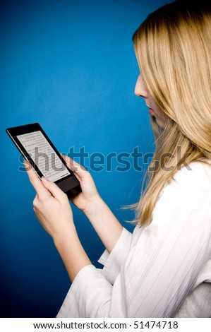blond girl reading electronic books on an ebook reader device