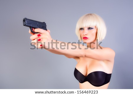 blond girl with a gun