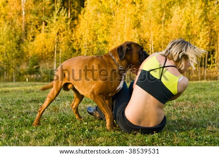 blond girl with big dog