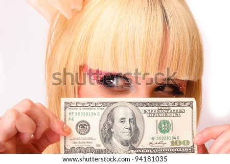 blond girl with dollar bill in hands