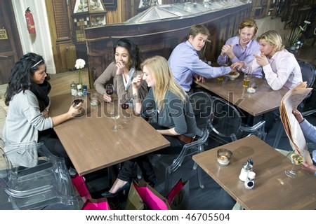 Blond guy being attracted to a blond girl at a different table in a cafe