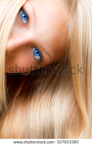 Blond Hair. Blonde Girl with Blue Eyes. Healthy Long Blond Hair. Hair Extension