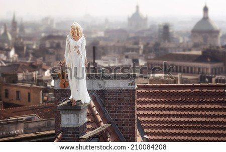 Stock Photo Blond haired woman with violin