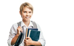 Blond happy schoolboy carrying books and schoolbag