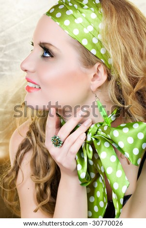 blond happy woman in retro polka dot scarf and headband