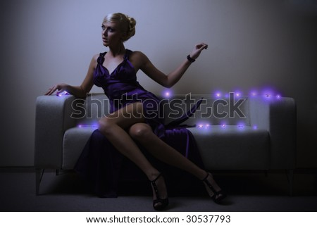 blond lady in violet dress