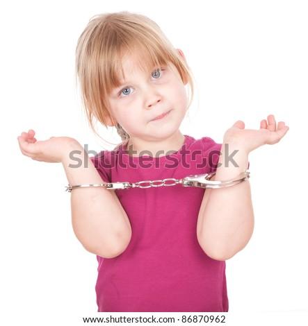 blond little girl in handcuffs, white background