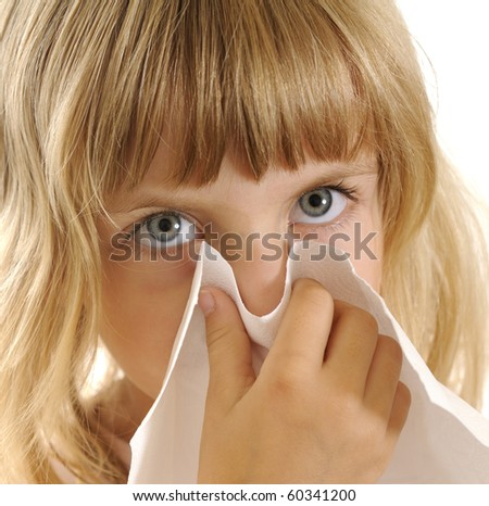 blond little girl with handkerchief - stock photo