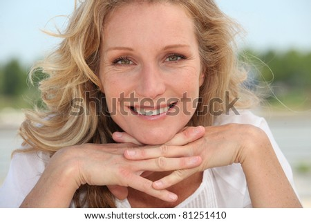 Blond resting head on hands