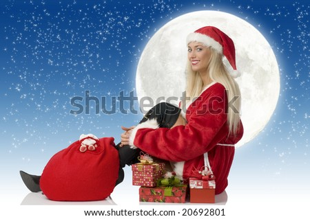 blond santa claus with gift and black boot sitting and smiling