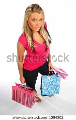 Blond sexy girl with hands full of bags
