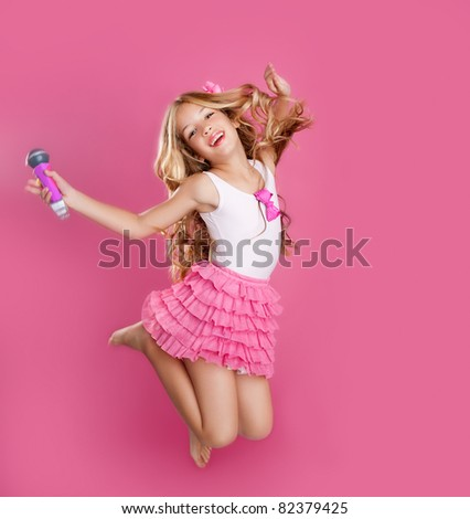 blond singer star girl like fashion doll with mic jumping high