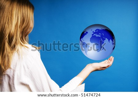 blond teenager girl holding a floating world globe