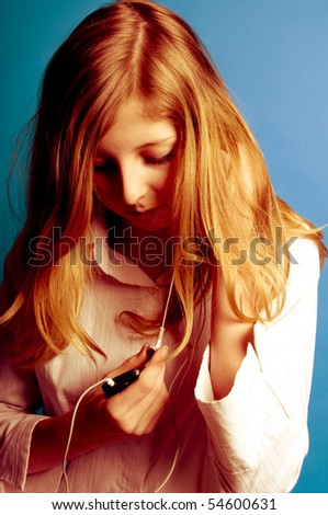 blond teenager girl listening music on her mp3 player