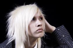 Blond teenager looking upward