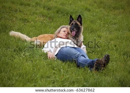 blond woman admiring her dog