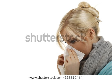 Blond woman blows her nose with a handkerchief