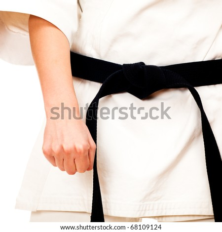 Blond woman doing karate, black belt, isolated on white