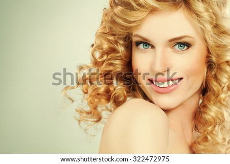 Blond Woman Fashion Model. Blond Curly Hair. Girl Smiling. Girl in Motion