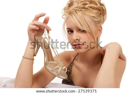 Blond Woman Holding A Gold Shoe