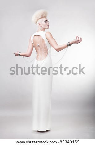 blond woman in dress with creative hairstyle and nacked back