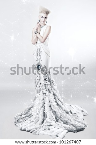 blond woman in long white dress with diamond