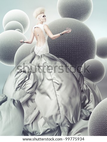 blond woman in magnificent grey dress with creative hairstyle