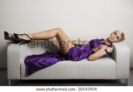 blond woman in violet dress