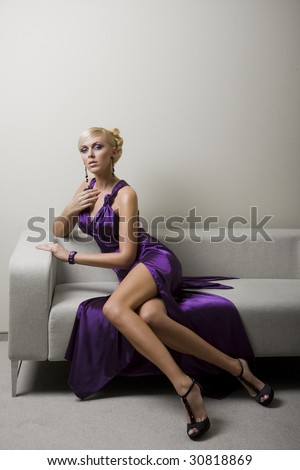 blond woman in violet dress - stock photo
