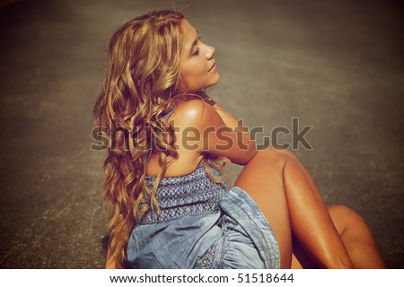 Blond woman on the road