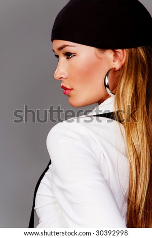 blond woman profile in white shirt and black head scarf
