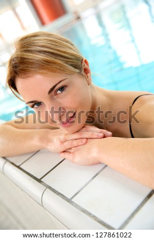 Blond woman relaxing in spa pool