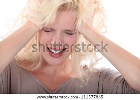 Blond woman suffering from headache
