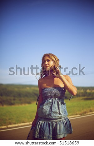 Blond woman walking on the road